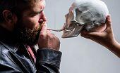 Man Smoking Cigarette Near Human Skull Symbol Of Death. Harmful Habits. Destroy Your Health. Smoking poster