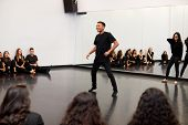 Male Student At Performing Arts School Performs Street Dance For Class And Teacher In Dance Studio poster
