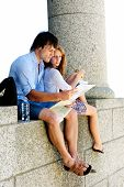 cute couple realise that they are lost an try to discover their location on a map