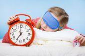 Sleeping Young Woman Wearing Cute Pink Pajamas Holding Big Red Old Fashioned Clock Showing Sleep Tim poster