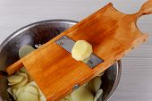 Bake Potatoes Slice In Plate Sliced Potatoes On Wooden Board poster