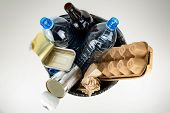 Plastic, Glass, Metal And Paper Garbage In Black Garbage Bag For Recycling Concept Reuse And Recycle poster