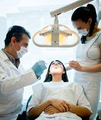 Woman visiting the dentist and having a treatment done