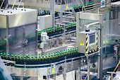Automated Beer Bottling Production Line. Packed Beer Bottles On Conveyor Belt. poster