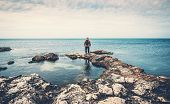 Man Standing On Stones At Sea Coast Looking At Horizon. Beach, Ocean Travel And Freedom Concept, Ton poster
