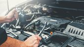 Auto Mechanic Working In Garage Technician Hands Of Car Mechanic Working In Auto Repair Service And poster