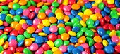 Candies Colorful Background With Multicolored Chocolate Coated Candy Top View Close Up. poster