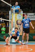 KAPOSVAR, HUNGARY - JANUARY 8: Alpar Szabo (L) in action at a Hungarian volleyball National Championship game Kaposvar vs. Dag, on January 8, 2012 in Kaposvar, Hungary.