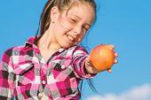 Kid Hold Ripe Apple Sunny Day. Healthy Nutrition Concept. Child Eat Ripe Apple Fall Harvest. Fruit V poster