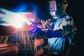 Welding work for steel. Welder industrial in the factory. Harm will happen to health of welder smoke poster