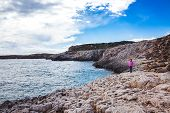 Llittle Girl Is Standing And Looking At The Sea On Beautiful Sea Shore In Cyprus. Beautiful Sea Shor poster