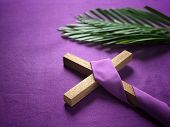 Good Friday, Lent Season And Holy Week Concept - A Religious Cross And Palm Leaves On Purple Backgro poster