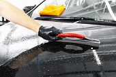 A Man Cleaning Car With Plastic Sponge. Car Detailing Or Valeting Concept. Selective Focus. Car Deta poster