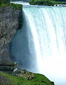 Water Mist From Millions Of Waterfall Water Spray. Beautiful Niagara Falls On A Clear Sunny Day. Nea poster