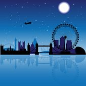 London silhouette at night with stars and moon on the background