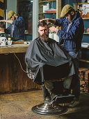 Hipster Client Getting Haircut. Barber With Clipper Trimming Hair On Temple Of Client. Hipster Lifes poster