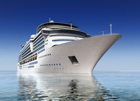 image of cruise ship  - luxury white cruise ship shot at angle at water level on a clear day with calm seas and blue sky - JPG
