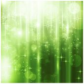 Light effects, blurry light dots and stars on a sparkling green background for your Christmas design