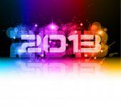 Fundo colorido da celebração do ano novo de 2013 com brilho e as cores do arco-íris