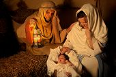 Living christmas nativity scene reenacted with a real 18 days old baby