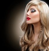 Beautiful Sexy Blond Girl. Long Hair. Blonde isolated on Black Background. Holiday Makeup.Make-up. G