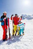 Skiing, winter fun - happy family skiers on ski holiday