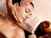 pic of low-necked  - Masseur doing massage on woman body in the spa salon - JPG