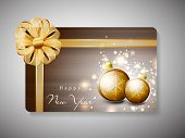 Gift card for Happy New Year celebration with golden ribbon and evening balls. EPS 10.