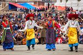 LEH, INDIA - SEPTEMBER 08: Young dancers in traditional Ladakhi Tibetan costumes perform folk dance