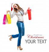 Santa Fashion Girl with Shopping Bags. Christmas Shopping. Sales. Full Length Portrait
