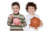 pic of piggy_bank  - Two happy children with moneybox savings isolated over white - JPG
