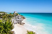 foto of mayan  - Beautiful beach with turquoise water in Tulum Mexico Mayan ruins on top of the cliff - JPG
