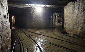 foto of catacombs  - Mine railway in a dark undergroud  with light - JPG