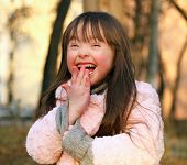 stock photo of playgroup  - Portrait of funny little girl outside  - JPG