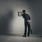 foto of voyeur  - A Businessman looking through keyhole - JPG