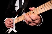 stock photo of low-necked  - Man playing his guitar - JPG