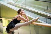 Ballet dancer at escalator