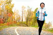 stock photo of foliage  - Mature Asian woman running active in her 50s - JPG