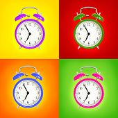 Alarm clocks isolated on colorful background. Pink, blue green and purple wake up alarm clock cut ou