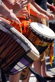 stock photo of penticton  - Close up of drumming by woman in bright clothes Penticton British Columbia Canada..