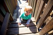 Boy Climbing Playground