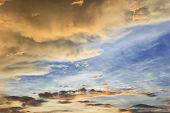 vivid sunset sky and rainy cloud