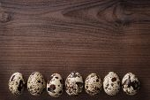 quail eggs on the brown wooden table background