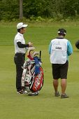 MOSCOW, RUSSIA - JULY 28: Wen-chong Liang of China with his caddie during final round of the M2M Russian Open at Tseleevo Golf & Polo Club in Moscow, Russia on July 28, 2013