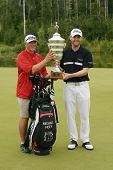 MOSCOW, RUSSIA - JULY 28: Michael Hoey of Northern Ireland and his caddie with the trophy of the M2M