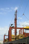 Freighter loaded with pine planks against the sky at Limassol Cyprus