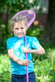 Happy Child Standing In Sunlights With Butterfly Net At Summer Day