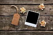 picture of wood craft  - Instant photo frame with gift tag and craft flowers on old wooden background - JPG