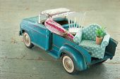 stock photo of packing  - Old vintage toy truck packed with furniture  - JPG