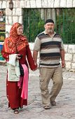 SARAJEVO, BOSNIA AND HERZEGOVINA - AUGUST 13, 2012: Muslim couple walk on Bascarsija, the old town.